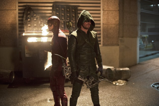 "The Flash -- ""Flash vs. Arrow"" -- Image FLA108c_0157b -- Pictured (L-R): Grant Gustin as The Flash and Stephen Amell as The Arrow -- Photo: Diyah Pera /The CW -- © 2014 The CW Network, LLC. All rights reserved."