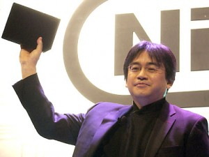 Nintendo President Satoru Iwata introduces the Nintendo Revolution game console at the Nintendo press conference in Los Angeles, Tuesday, May 17, 2005. The Revolution game console will debut in 2006. (AP Photo/Matt Sayles)